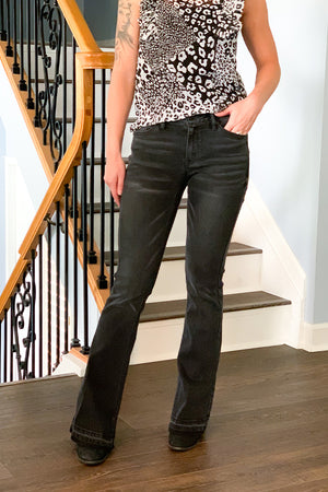 There ain't nothing that a great pair of flares can't fix! If you loved our Mid Rise Flare Jeans With Side Slit then you'll love our Dark Grey Mid Rise Flare Jeans by KanCan.  These are the perfect mid-rise jeans that sits at the hip, slightly fitted through hip and thigh, and are stretchy for maximum comfort all day.  Classic 5 pockets and slit details inside the ankle give this flare jean an extra flare.  These are true to size.