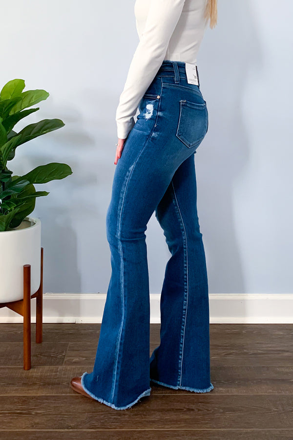 Seriously the cutest flares ever!  Our KanCan Double Button High Rise Flare Jeans are all about the details featuring a double button closure, cute waistband detail, frayed hems, and light distressing.  Pair with a bodysuit and your favorite booties to complete the look. KC7344M