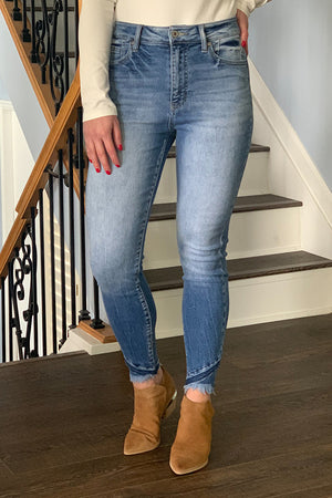 Ready to get compliments in your new jeans? You'll be sure to get them in these High Rise Ankle Detail Skinny by KanCan.  These skinny ankle jeans have the cutest details featuring frayed hems and a subtle detailed pocket. Pair with booties and a graphic tee for a fun outfit. If in between sizes, we recommend to size down.