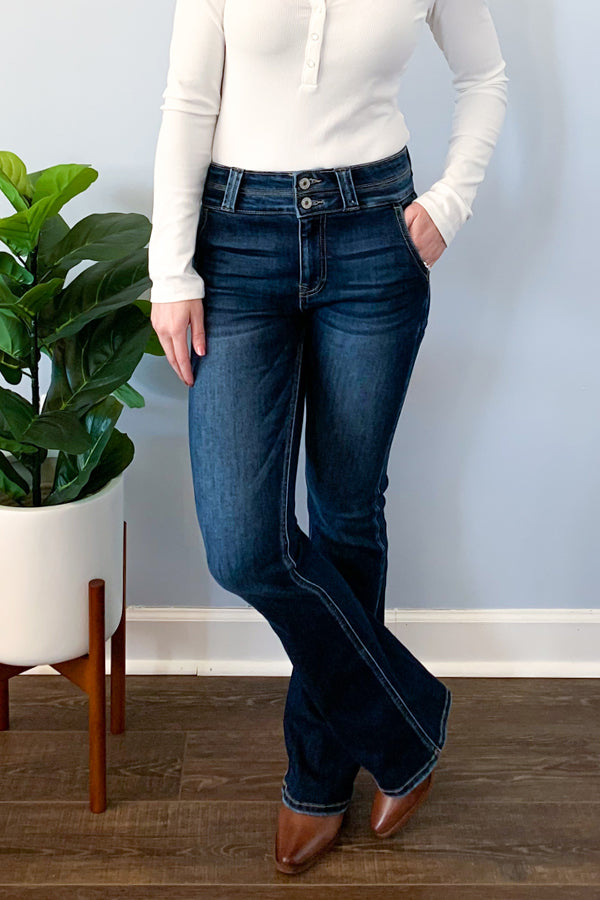 A girl can never have too many jeans! And you can't go wrong with these KanCan High Rise Bootcut Jeans.  These dark wash denim features two button closure, the cutest side pockets, and bootcut bottom.  Complete the look with our ribbed henley bodysuit and checkered crossbody clutch!