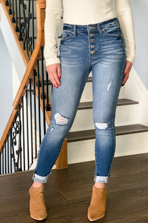 Let's just take a moment and appreciate these AMAZING skinny jeans!! These High Rise Button Fly Distressed Skinny Jeans by KanCan will be your favorite go-to jeans!  High rise jeans with a trendy button fly featuring minimal distressing and distressed cuffed hem.  Pair with our henley bodysuits and your favorite booties to complete the outfit.  These jeans are true to size. If you are in between sizes, we recommend to size up.