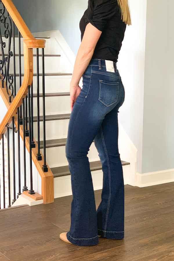 We're loving these trouser style jeans.  The KanCan High Rise Button Fly Flare Jeans are perfect for dressing up with a cute blouse and heels.  These dark wash denim features faux front pockets, back pockets, and an exposed button fly.  These will definitely be your go-to jeans all year.  These flares have a comfortable stretch to them so you can size down if in between sizes.