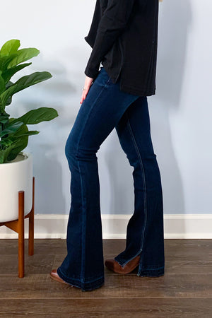 Our best selling Mid Rise Button Front Flare Jeans With Side Slit by KanCan are back! But this time in a classic dark wash denim.  These cute flares feature a button up closure and inner side slits. Perfect for pairing with your favorite boots.  If between sizes, we recommend sizing down for a snugger fit. KC7338D