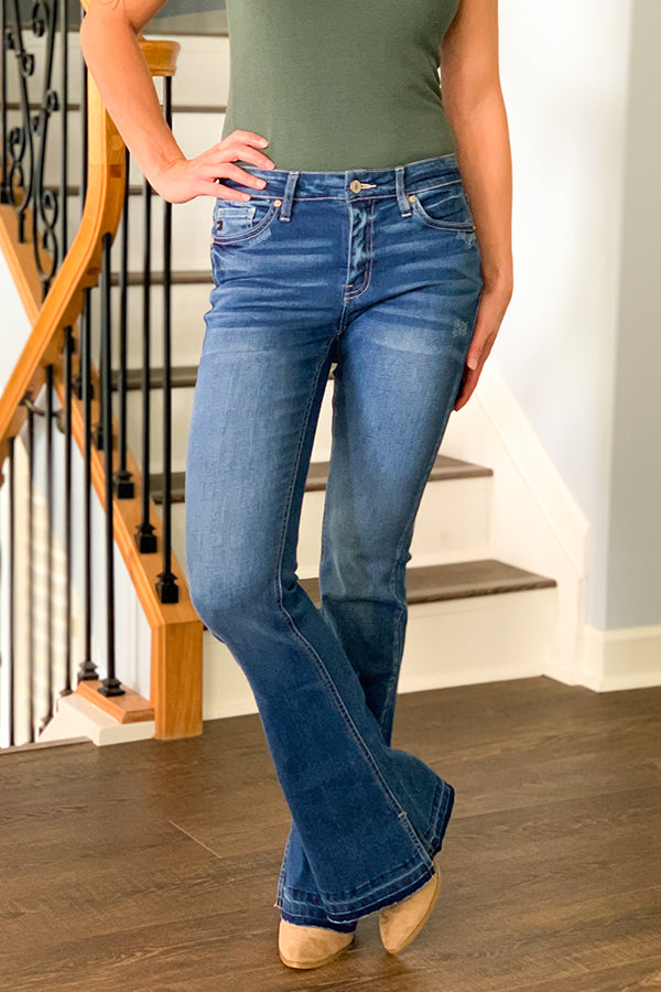 We loved these KanCan flarse so much we brought you them in medium wash! The KanCan Mid Rise Flare Jeans With Side Slit in medium wash are the perfect mid-rise jean that sits at the hip, slightly fitted through hip and thigh, and are stretchy for maximum comfort all day.  Classic 5 pockets and slit details inside the ankle give this flare jean an extra flare.