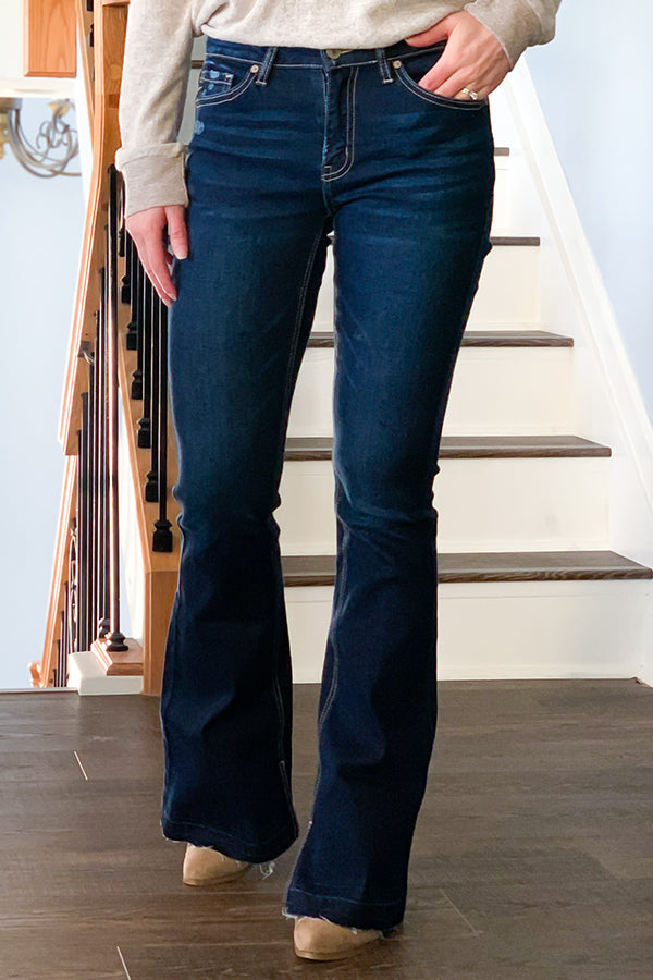 The KanCan Mid Rise Flare Jeans With Side Slit are the perfect mid-rise jean that sits at the hip, slightly fitted through hip and thigh, and are stretchy for maximum comfort all day.  Classic 5 pockets and slit details inside the ankle give this flare jean an extra flare.