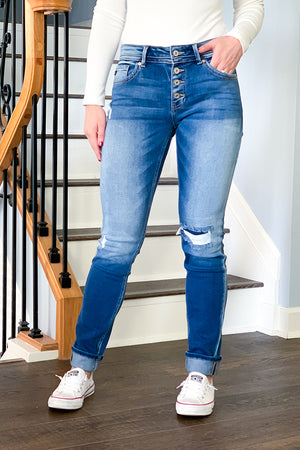 Feel comfy and look chic in our KanCan Mid Rise Repaired Skinny Straight Jeans.  These are a faded medium wash denim featuring a four button closure, mid rise fit, and patched distressing at the knee. These straight skinny jeans can be worn cuffed or uncuffed. The best jeans for any season!