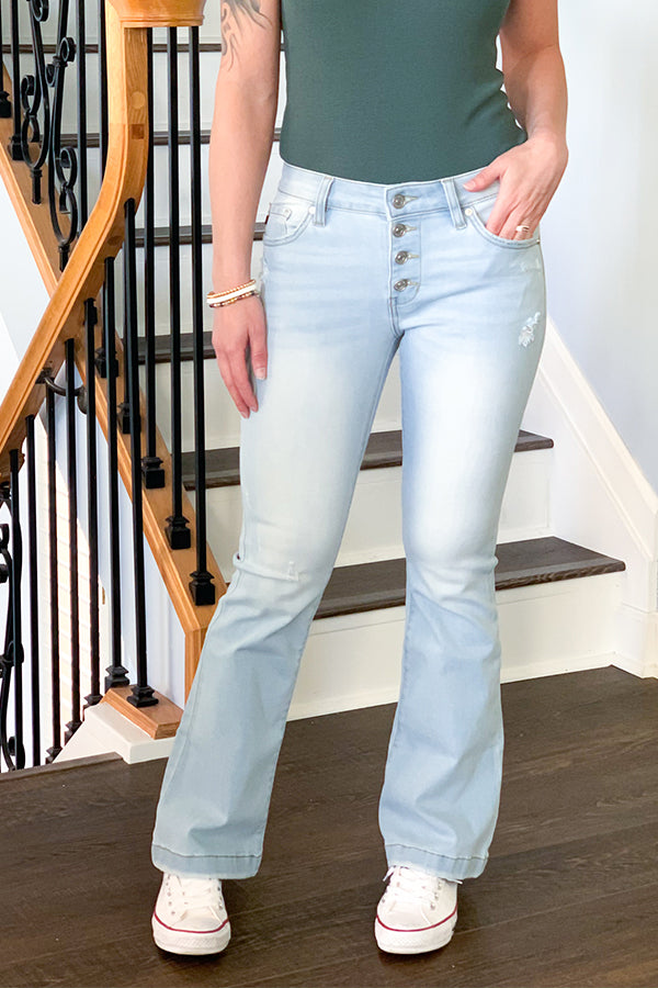 For the beautiful petite ladies, our KanCan Petite Mid Rise Button Fly Flare in Light Wash are perfection!  These flare jeans are a light blue wash with minimal distressing.  These mid-rise jeans feature a sealed hem, four-button closure, and stretchy fabric.