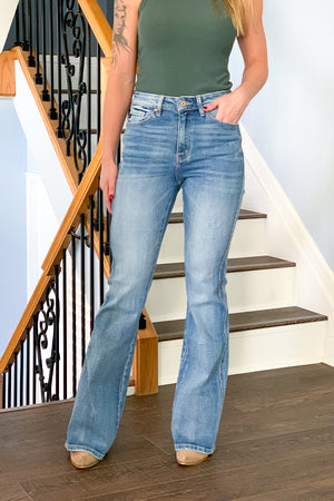 The perfect statement jeans for any season! Our KanCan Slightly Distressed High Rise Flare Jeans are a medium wash denim featuring light fading and subtle whiskering.  These high rise, retro styles jeans have a subtle amount of stretch and are fitted in waist, hip, and thigh.  We love pairing these with a racerback tank and cute cardigan.  And don't forget your booties!!