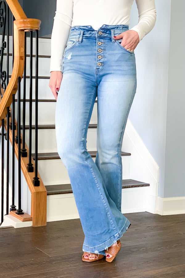 There once was a girl who fell in love with jeans.  That girl was you and those jeans were our KanCan Ultra High Rise Flare Jeans!  These light wash flares feature a classic vintage look with slight distressing, five button fly closure, waist band detail, and an ultra high rise fit.  These are a curvy fit which means it's stretch fabric will hug and lift in all the right places.  Talk about a perfect silhouette.  The perfect jeans for any season!