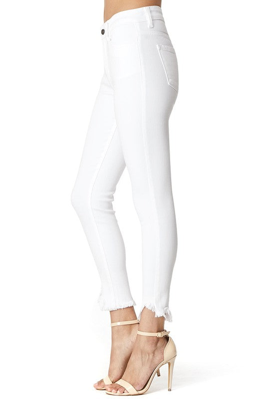 Our KanCan White Skinny Jeans With Raw Hem will be the best skinny jeans for Spring and Summer! Featuring super soft, white wash fabric, and raw hem ankle detail.  Complete with front zipper fly and classic 5 pockets.  Pair these with a cute colorful blouse and heels for a fun, spring outfit.