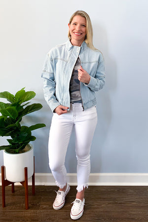 We're getting cool girl vibes with our Light Blue Denim Bomber Jacket.  This denim jacket features a bomber style, zip up closure, elastic back waistline, and snap front and cuff closure.  We love the unique detail stitching.  Dress up or wear casual, either way, you'll look amazing!  Pair with our Hand Dyed Blue Camo Tee and KanCan White Skinny Jeans to complete the look.