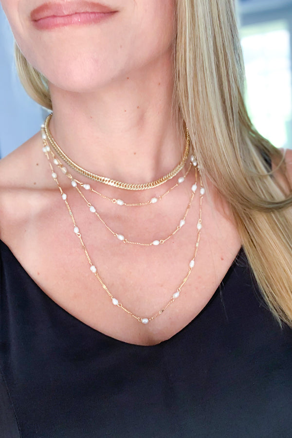 "Beautiful gold tone layered necklace with pearl detail.  Layered gold tone and pearl necklace 16"" length 3"" extender"