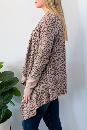 Look chic and feel comfy in our Leopard Waterfall Cardigan In Mocha! This drape cardigan features a mocha leopard print and contrast cuff detail.  Throw it on over a basic cami and skinny jeans for an effortless outfit.  This super cute cardigan will be your favorite throw over cardigan!  Mittoshop