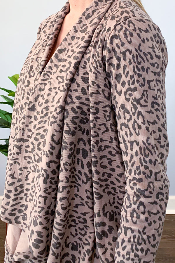 Mittoshop cardigan. Look chic and feel comfy in our Leopard Waterfall Cardigan In Mocha! This drape cardigan features a mocha leopard print and contrast cuff detail.  Throw it on over a basic cami and skinny jeans for an effortless outfit.  This super cute cardigan will be your favorite throw over cardigan!