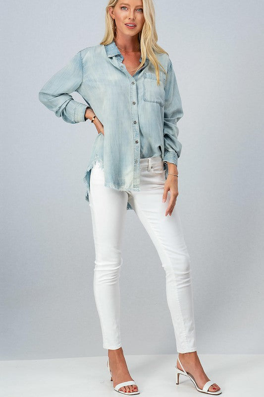 The perfect essential you need this season!  Our Light Wash Frayed Hem Denim Shirt will be your go-to top for many seasons to come!  This soft lyocell fabric top features a high-low frayed hem, minimal distressing through out, front bust pockets, and button closure.  The perfect fall essential for your every day wardrobe!  Perfect for pairing with leggings and your favorite sneakers!  Dress it up with skinny jeans and booties for a fun, fall outfit!