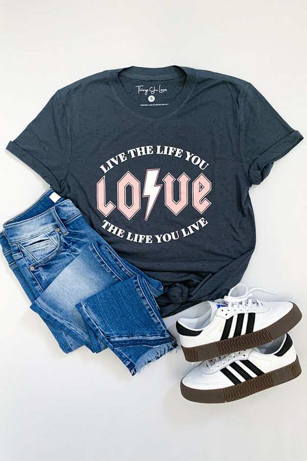 We're thunderstuck with our Rock Band Inspired Live The Life You Love Graphic Tee!  This short sleeve graphic tee is a charcoal grey base with cute grey flecks all throughout. with pink lettering.  Perfect for wearing for Valentines Day with a cardigan or any other time of the year!  Live The Life You Love! Love The Life You Live! That's pretty much our saying here!