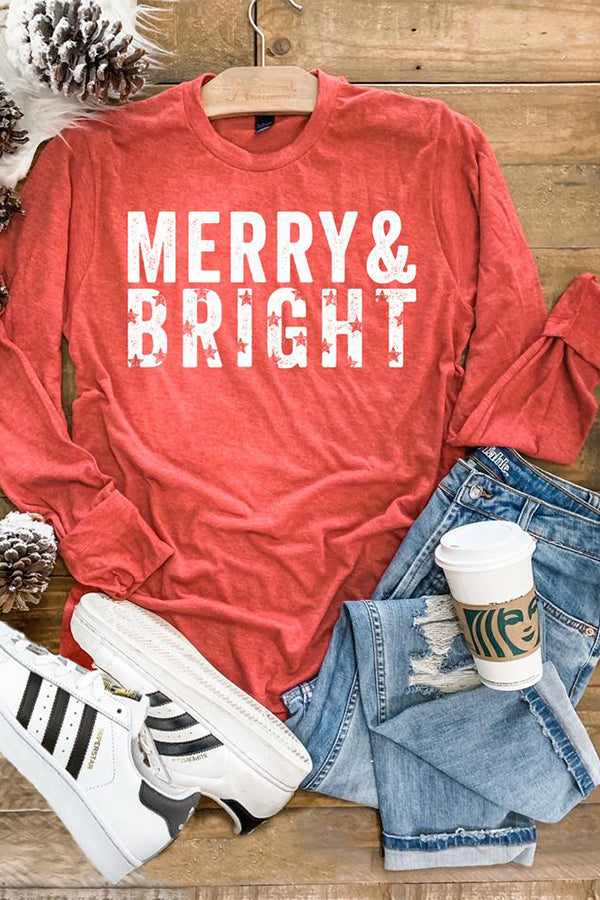 Get ready for the Holiday with this cute graphic Tee! Our Merry & Bright Long Sleeve Graphic Tee is sure to get you in the holiday mood!  This long sleeve graphic tee features the white lettering on a heather red tee.  We love the star cutouts in the word Bright. This tee is comfy and perfect for pairing with our Confetti Cardigan With Pockets for chilly days!