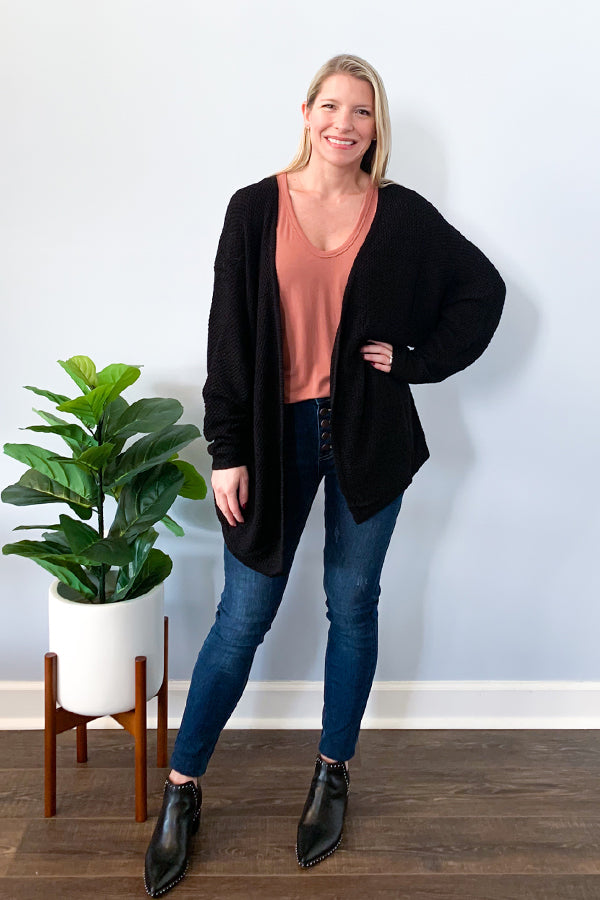 Our Black Knit Cardigan is a must have for fall!  This cable knit sweater cardigan is lightweight and features an open front, relaxed fit, and batwing style sleeves.  So cute paired with our Dusty Rose Basic Scoop Neck Tank Top and Judy Blue Button Fly High Rise Skinny Jeans.  Finish the look with a cute pair of booties.