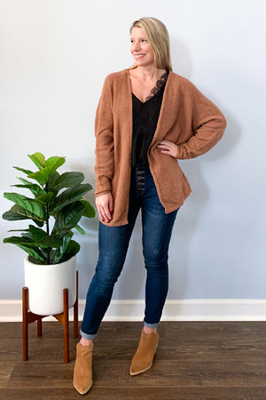 Our Mocha Knit Cardigan makes a perfect light weight layer for fall!  This cable knit sweater cardigan has an open front, relaxed fit, and batwing style sleeves.  So cute paired with our Black Lace Trim Chiffon Blouse and Judy Blue Button Fly High Rise Skinny Jeans.  Finish the look with a cute pair of booties. Mittoshop cardigan