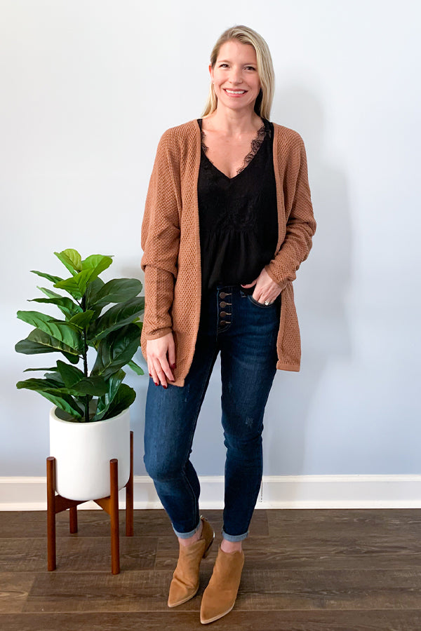 Our Mocha Knit Cardigan makes a perfect light weight layer for fall!  This cable knit sweater cardigan has an open front, relaxed fit, and batwing style sleeves.  So cute paired with our Black Lace Trim Chiffon Blouse and Judy Blue Button Fly High Rise Skinny Jeans.  Finish the look with a cute pair of booties.