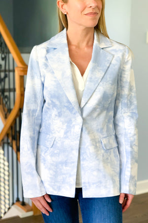 Our Light Blue Tie Dye Blazer is a game changer! This trendy tie dye print blazer features a notched collar, button closure, and long sleeves. Pair this chic blazer with jeans and a white blouse to upgrade your look! Moodie Tie Dye Blazer.