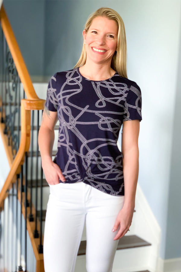 We're loving the trendy chain pattern in our Dex Navy Chain Print Tee With Twist Front Detail.  This soft tee features short sleeves, chain print pattern on a navy base, and twist front detail.  This tee is stretchy and perfect for a casual event outfit.  Pair with your favorite jean shorts and white sneakers for a cute summer outfit.  Pair with white jeans and wedge for a fun spring-time outfit.