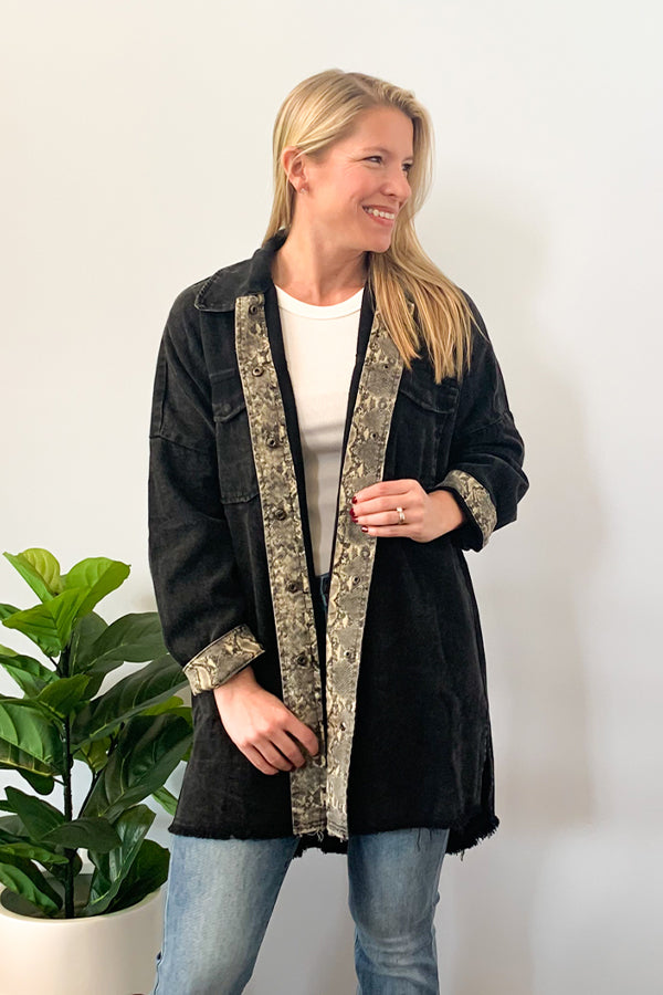 We're loving the comfy and edgy style of our Oversized Black Jacket With Snake Skin Detail. This faded black shirt jacket features a unique snake print contrast along the open front, cuffs, and back of collar.  Finished with snap front closure and a frayed shirt hemline.  Easy to throw over a graphic tee or basic tank for an easy, effortless style.  This has an oversized fit so we recommend sizing down if you want a more fitted style.