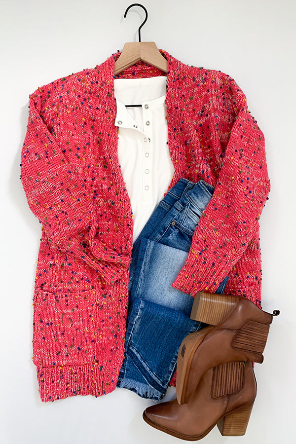 We are seriously crushing on our Pink Confetti Cardigan With Pockets!! We loved our cream version so much that we just had to bring in this amazing pink color! This super cozy cardigan features an open front, long sleeves, and front pockets.  Pairs easily and effortlessly with a graphic tee, skinny jeans, and your favorite booties.  Super cute to wear for Valentines Day or any other day!