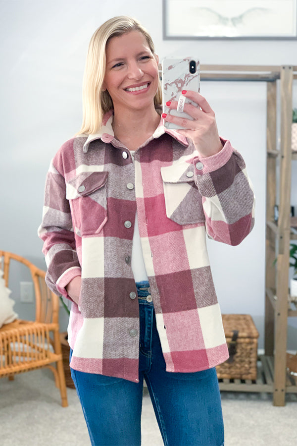 Our Pink Plaid Shacket is the perfect on-trend layering piece.  Featuring an off white and pink big plaid print, medium weight fabric, collared neckline, side pockets, and button up detailing.  This is the perfect go-to throw on piece!  Throw over a basic tee and your favorite flares to complete the look!