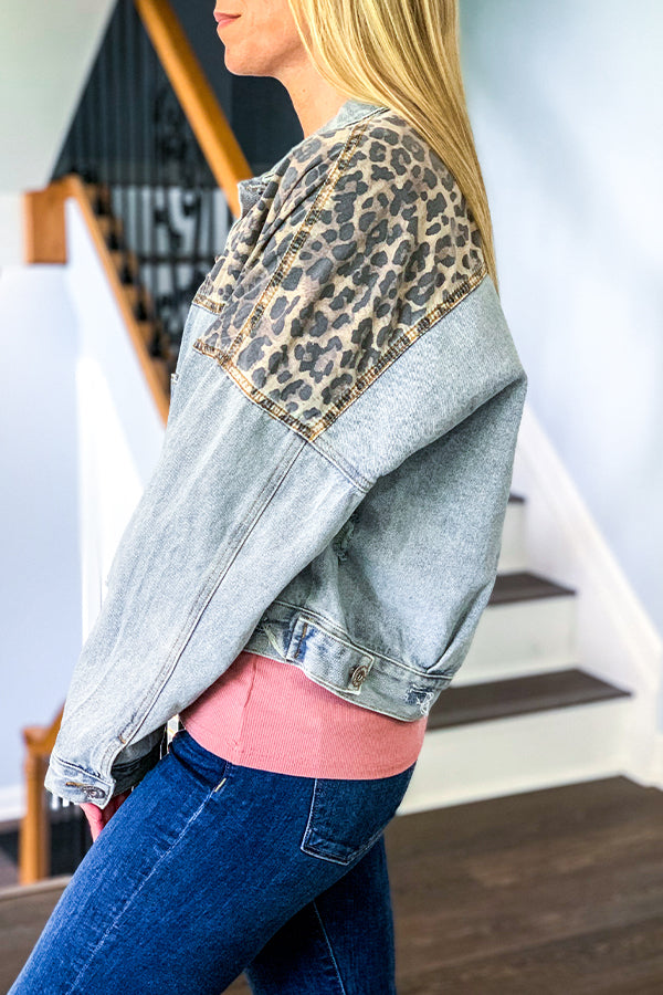 I'm not going to lie, our Leopard Denim Jacket is pretty awesome!  This relaxed denim jacket features a cute leopard print mixed fabric, front patch pockets, and button closure.  This fun, unique jacket is a must-have for any season!