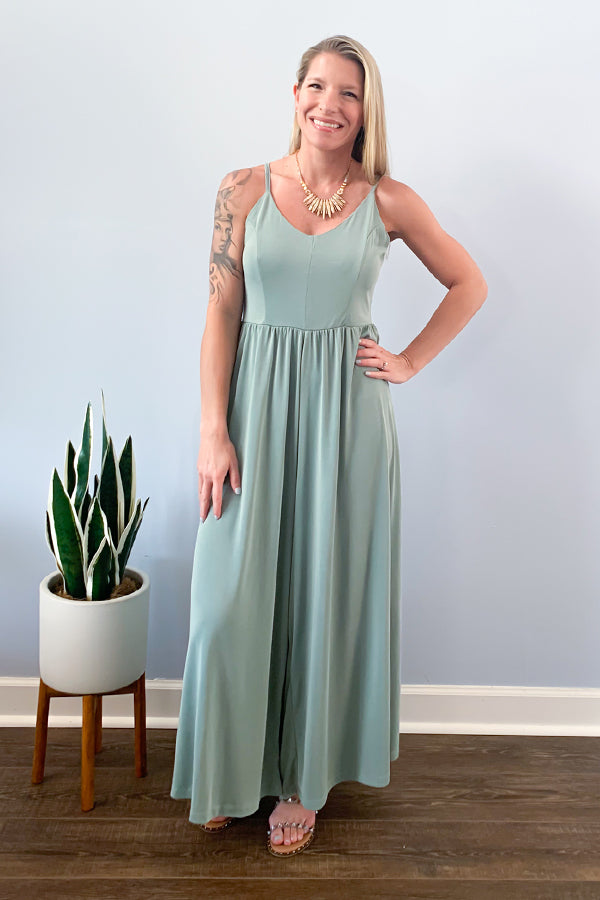 Mystree Sage Wide Leg Jumpsuit. From week to workweek, this casual, jumpsuit is going to keep you comfy all-day long! This cute Sage Wide-Leg Jumpsuit features a soft jersey knit, cinched waist, and adjustable straps.  This piece will be your go-to jumpsuit.  Pair with a cute wedge and denim jacket for a casual work outfit.  Pair with sandals to lounge around the house or for your next beach vacation.