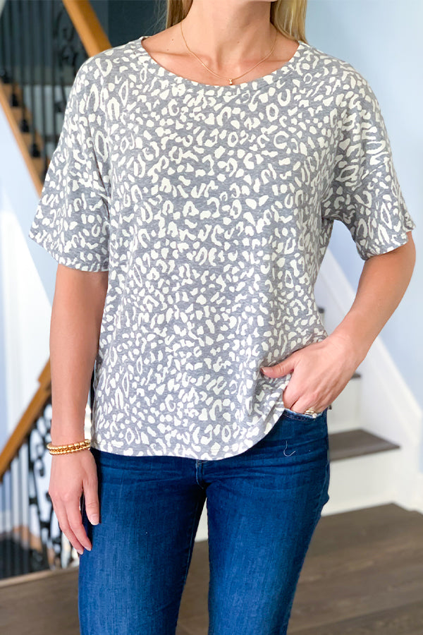 Feel comfy and trendy in our Grey Leopard Tee! This relaxed fit tee features a fun leopard print, half sleeves, and round neckline.  Pair this soft tee with jean shorts and sandals to complete your summer outfit or pair with skinny jeans and boots to head into fall. Six Fifty clothing.