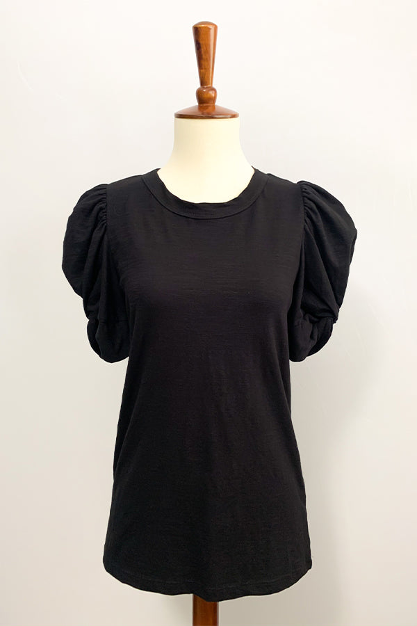 Six Fifty Puff Sleeve Top. Our Black Short Sleeve Puff Sleeve Tee will definitely be your go-to tee this season! Fun puff sleeves with a twist detail adds a playful touch to this not so basic tee.  Pair with distressed jeans and wedge sandals.  Perfect for dressing up or wearing casual.  Round Neckline Short Sleeves Puff Sleeve Detail 98% Cotton / 2% Spandex Care: Machine Wash Made in U.S.A.