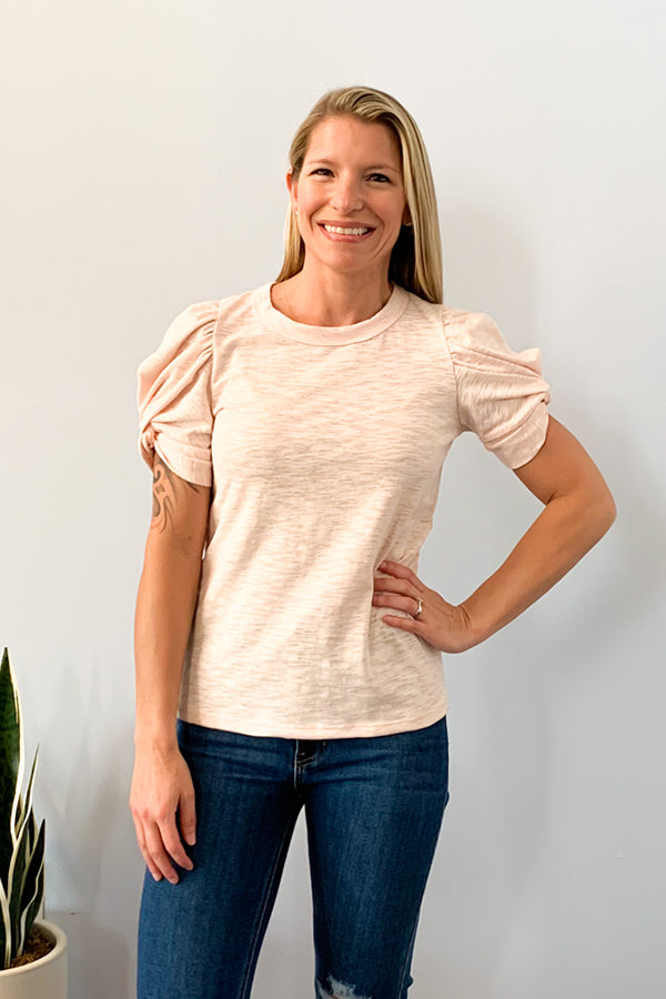 Six Fifty Clothing. Take your basic tee up a notch with the Blush Short Sleeve Puff Sleeve Tee.  Cute puff sleeves with a twist detail adds a touch of femininity to any outfit.  Perfect for dressing up or down.  Pair with your favorite shorts and sandals for a casual outfit or pair with skinny jeans and heels for a night out at your favorite restaurant.  Round Neckline Short Sleeves Puff Sleeve Detail 98% Cotton / 2% Spandex Care: Machine Wash Made in U.S.A.