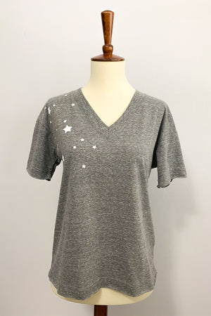 Six Fifty Tee. Reach for the stars in the Star V-neck Tee in Grey.  Grey basic tee featuring a v-neckline, raw hem short sleeves, and scattered star print on right side.  This tee sits at the waistline.  Perfect for pairing with distressed denim and your favorite sneakers for a causal outfit.  V-Neckline Raw Hem Sleeves Raw Hem Waist Scattered Star Print 50% Polyester / 37% Cotton / 13% Rayon Care: Hand Wash Made in U.S.A.