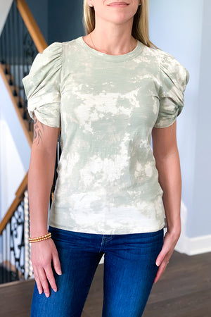 We are obsessed with our Short Sleeve Puff Sleeve Tees and now we have in this fun, trendy tie dye pattern.  Cute puff sleeves with a twist detail adds a sweetness to this not so basic tee.  Pair with white skinny jeans and wedge sandals for a trendy outfit.  Perfect for dressing up or wearing casual.  These sage colored tees are hand made tie-dye so each pattern might be different but still equally cute!