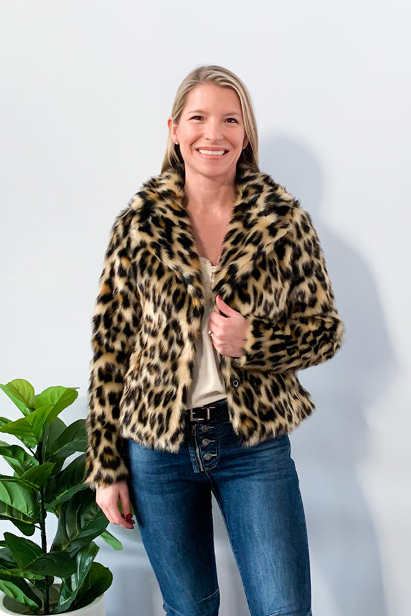 Statement coats are always a must-have for the chic woman's wardrobe.  The Faux Fur Leopard Print Coat is just that!  The fun leopard print adds a luxurious glam factor to your fall and winter wardrobe.  Soft, faux fur, lined with a satin like fabric.  This is the perfect coat for a dinner night out on the town during those chilly nights.