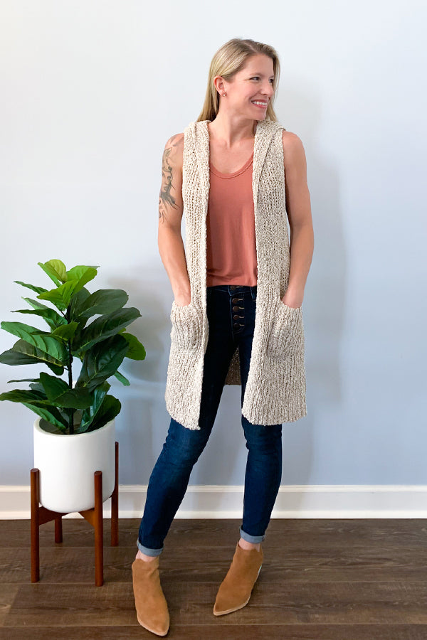 The cutest layering piece is here!  Our Sweater Vest With Hoodie will keep you cozy with it's open knit sweater fabric and hoodie.  Finished with front pockets to give your look an extra cute touch.  This oatmeal colored cardigan vest has a relaxed fit and goes perfectly with skinny jeans, a cute cami, and your favorite boots!  Perfect for an effortless look!