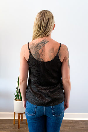 Add a subtle touch of animal print with the Black Satin Animal Print Camisole features an all-over jacquard animal print and trimmed neckline with delicate lace.  This cami is fully lined and makes it perfect for wearing alone or underneath your favorite blazer.