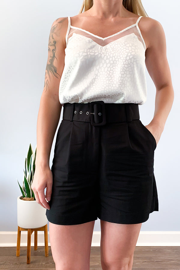 Your new favorite dress shorts are here! The Black Structured Shorts With Belt are perfect for dressing up or wearing casually.  Cute belt closure and trendy high-waist will keep you looking chic and cool during the warmer seasons.  Pair with our Chic Black Blazer for an effortless outfit.