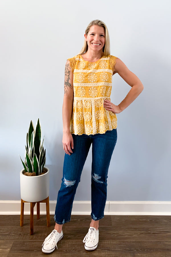 Skies are blue. Some days you just have to create your own sunshine! Create your own sunshine with our Yellow Eyelet Lace Top.  This beautiful eyelet lace top is stitched with an all over embroidered pattern and features a cute scalloped hemline and cap sleeves.  This top adds a pop of color to any outfit.