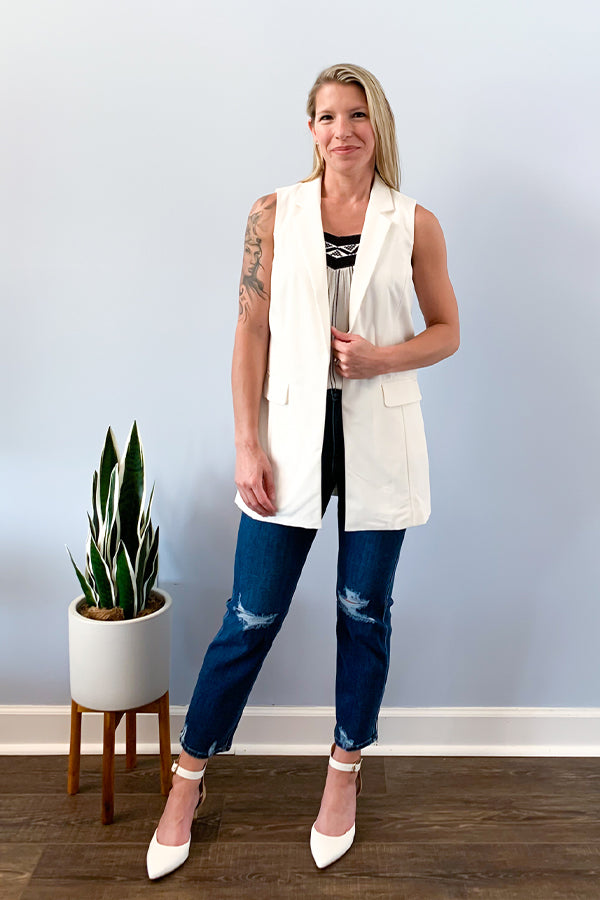 Add sophistication to your outfit with the Chic White Blazer Vest. This cute blazer vest features an open front, long line silhouette, notched lapels, and flap pockets.  This blazer is perfect for layering and is just one of those must-have chic pieces your closet.  Pair with jeans and heels for a casual chic outfit.