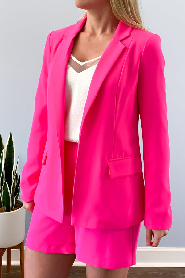 Nothing makes a statement like this Neon Pink Blazer.  This trendy neon blazer features notched lapels and welted flap pockets.  This tailored fit blazer is perfect for pairing with our Neon Pink Structured Shorts and Ivory Satin Animal Print Camisole.  Or wear over a cami and pair with jeans for a casual chic outfit.