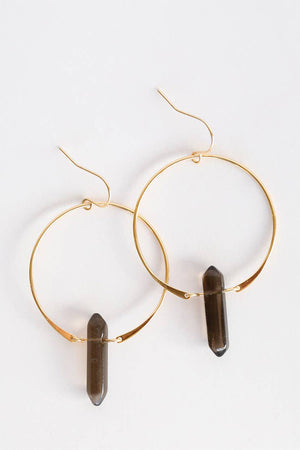 "Beautiful Smoky Quartz Hoop Earrings featuring double pointed crystals handcrafted out of 18kt gold over sterling silver.  These chic hoop earrings measures 1.5"" in diameter and each polished gemstone is roughly 1"" x 0.25"" wide.  Smoky quartz is known for its grounding, balancing, and protective vibrations.  It works to ground the wear back into the earth while promoting heart-opening energies."