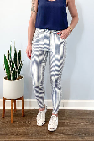 Velvet Heart. Change up your everyday jean wardrobe for these fun Striped Skinny Jeans With Raw Edge.  These mid-rise skinny jeans featuring a navy and white striped pattern, raw hem edge, five-pocket, and zip fly and button closure.  Keep casual with a basic t-shirt or an over-sized sweatshirt.