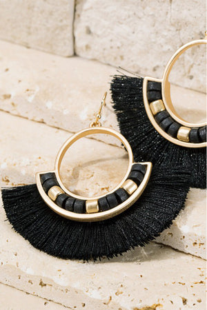 "Add a fun touch to any outfit with these tassel and wood bead earrings.  Gorgeous metal ring and fine thread tassel  finished with wood bead accent.  Approximately length is 2"" and width is 2 1/4"" Nickle/lead compliant"
