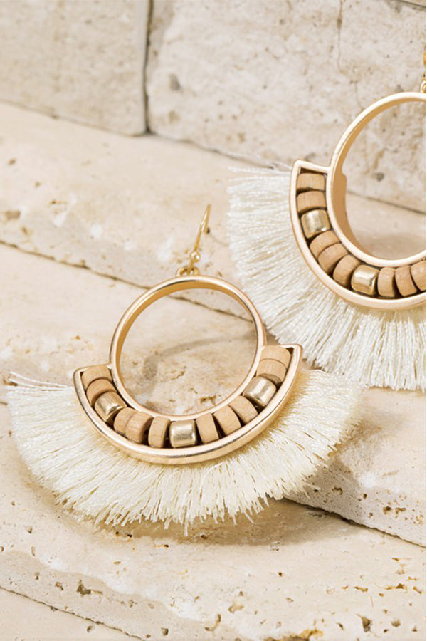 "Add a fun touch of ivory to any outfit with these tassel and wood bead earrings.  Gorgeous metal ring and fine thread tassel  finished with wood bead accent.  Approximately length is 2"" and width is 2 1/4"" Nickle/lead compliant"