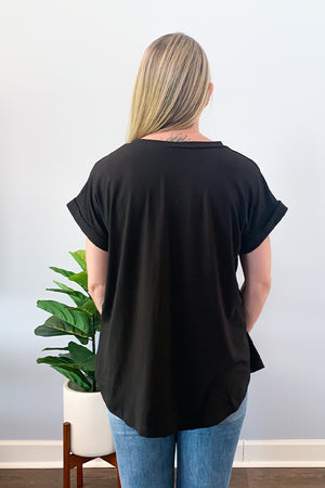 Grab our Best Basic V Neck Tee in Black and make it your everyday staple!! This super soft tee features a v-neckline, front bust pocket, round hem, and cute cuffed sleeves.  This top is the best! Seriously, the material is a thicker material and super soft which makes it super comfy.  Perfect for layering or wearing as is!  This basic tee is definitely a closet essential for any season!