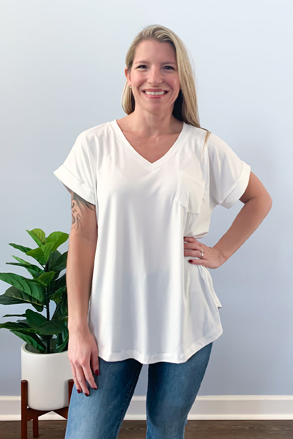 Grab our Best Basic V Neck Tee in White and make it your everyday staple!! This super soft tee features a v-neckline, front bust pocket, round hem, and cute cuffed sleeves.  This top is the best! Seriously, the material is a thicker material so no need to worry about it being see through.  Perfect for layering or wearing as is!  This basic tee is definitely a closet essential!