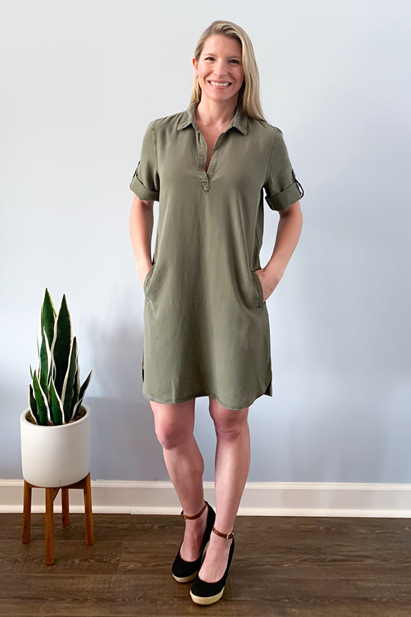 The perfect dress for a casual comfy weekend!  The Velvet Heart Macey Olive Green Tunic Dress features a v-neckline, rolled tab short sleeves with button, side pockets (yeah!) and made with a beautiful olive green soft tencel fabric.  This shirt style dress has a slight high-low hem. Definitely a must-have for your closet this season!  So cute paired with sandals or a wedge for a week to weekend outfit.